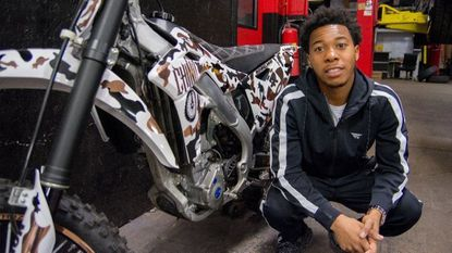 "Baltimore dirt biker Pacino ""Chino"" Braxton is auctioning off his custom bike to benefit local program B-360, which aims to educate and attract more students of color to STEM, while also making dirt bike riding safer."