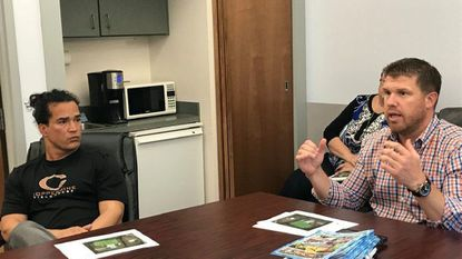 Alex Jacobs, right, owner of Coppermine Fieldhouse, speaks with the Aberdeen mayor and City Council Monday about the Aberdeen Family Swim Center. Keith Kormanik, left, is a Coppermine director.