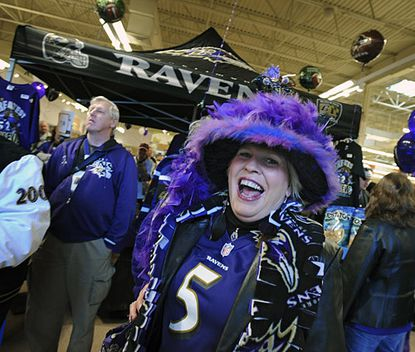 Sue Dana, of Timonium, who wore this hat to last week's Purple Friday events, arrive at the Giant supermarket for this week's Ravens Playoff Purple Friday Caravan. Ravens fans show team spirit by attending Ravens Purple Friday events at different locations around Baltimore to cheer on the underdog Ravens in tomorrow's playoff game against the Broncos.