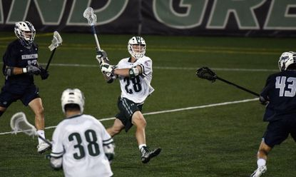 Bailey Savio, Loyola, takes a shot and scores in the 3rd quarter to put the Greyhounds ahead of Georgetown 8-7.