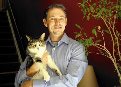 """David Grimm, author of """"Citizen Canine: Our Evolving Relationship with Cats and Dogs."""""""