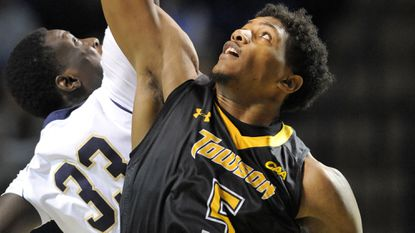 Towson's Walter Foster fights Navy's Edward Alade for the jump ball in December.