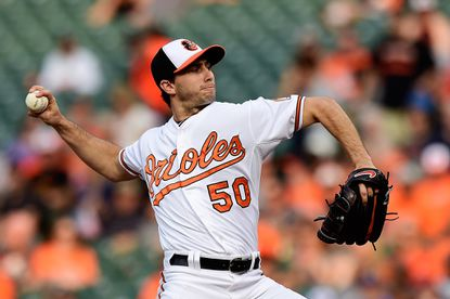 Starting pitcher Miguel Gonzalez #50 of the Baltimore Orioles throws a pitch to a Boston Red Sox batter in the first inning during a baseball game at Oriole Park at Camden Yards on June 9, 2015 in Baltimore, Maryland. Gonzalez left the game in the fifth inning with an injury.
