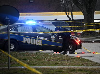 Officers investigate a shooting of an individual in the 800 block of Bethune Road in the Cherry Hill neighborhood Monday.