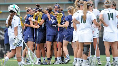 Navy celebrates a goal against host Loyola Maryland in the 2017 Patriot League championship game. The Mids won, 15-5.