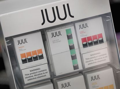 Electronic cigarettes and pods by Juul, the nation's largest maker of vaping products, are offered for sale at the Smoke Depot in Chicago, Illinois.