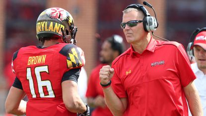 Coach Randy Edsall, right, and the Terps football team only need one more win to become eligible for a bowl game.