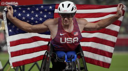 Daniel Romanchuk celebrates during the men's 400-meter T54 wheelchair race at the National Stadium in Tokyo on Sunday.