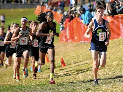Severna Park's Andrew Forsyth, right, competes in the boys class 4A final during the Maryland State Cross Country Championships at Hereford High School Saturday, Nov. 8.
