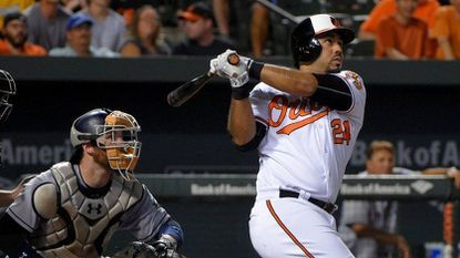 Baltimore Orioles designated hitter Pedro Alvarez follows through on his second home run of the night against the San Diego Padres at Oriole Park at Camden Yards in 2016.