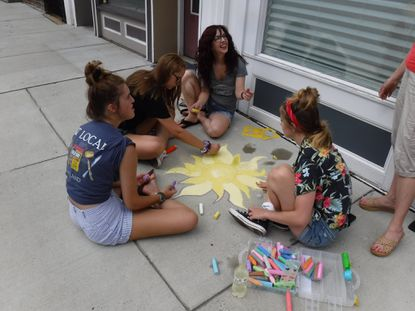 Fun in the Sun attendees participate in the annual sidewalk chalk art competition in 2018.