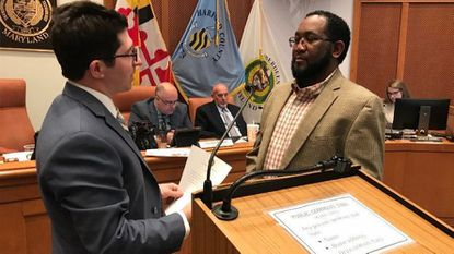 Terrell Boothe, right, is sworn in by Mayor Patrick McGrady as a new member of the Aberdeen Economic Development Commission at Monday's city council meeting.