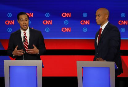 Former Housing and Urban Development Secretary Julian Castro speaks as Sen. Cory Booker, D-N.J., listens during the second of two Democratic presidential primary debates hosted by CNN Wednesday, July 31, 2019, in the Fox Theatre in Detroit. (AP Photo/Paul Sancya)