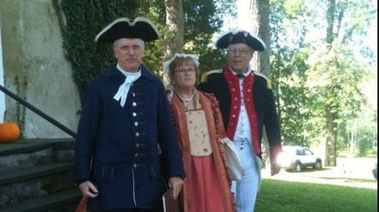 Art Thomas (portraying John Wesley), and Sandi and Bill Smithson (representing early Methodists) are in period outfits for the Strawbridge Shrine annual meeting in 2015.