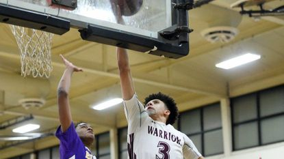 Havre de Grace's Gary Gibson, shown in recent action against Elkton, scored 15 points Thursday night to lead the Warriors to their 20th straight win.