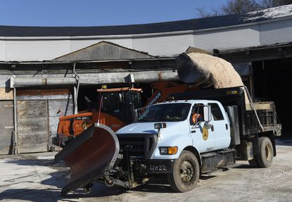 A Baltimore city snow plow truck is loaded with salt at the city transportation lot on Falls Road.