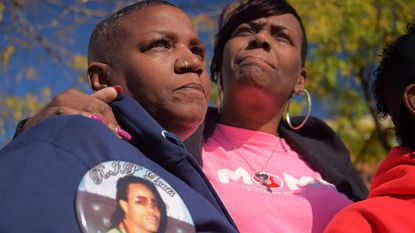 Dorothy Scriberm, left, stands next to Cynthia Collins during a press conference held by Mothers of Murdered Sons and Daughters United to address the city's violence.