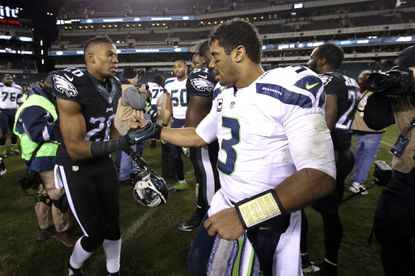 Cary Williams shakes hands with Seattle Seahawks quarterback Russell Wilson after a game in December. Could they be teammates in 2015?