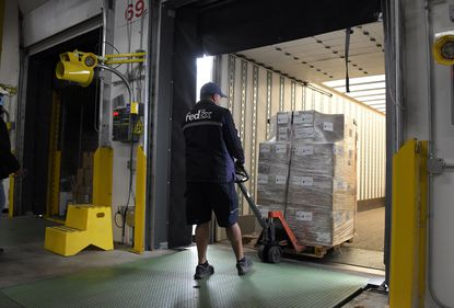 FedEx driver Chris Ramdeen delivers ventilators Thursday to the state of Maryland that the state ordered from Blue Flame Medical LLC. The shipment of 27 ventilators arrived at a warehouse in Sparrows Point.