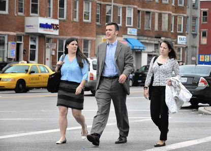 """Sarah Ceponis, from left, Wes William and Kelleigh Eastman are three young Baltimore Corps fellows working with Baltimore City's health department to help lead the agency's """"public health recovery"""" project following the recent unrest in West Baltimore."""