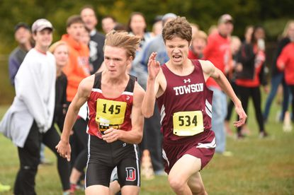 In the 2015 Baltimore County boys cross country championship race, Dulaney's Matt Owens, left, nipped Towson's Vaughn Parts to finish fifth. That gave the champion Lions the first five spots in the race and a perfect score of 15. Parts has graduated, but his former teammate Jonathan Ellis is a threat to be among the leaders at the race which will be held at Dulaney High on Oct. 22 at 11 a.m.