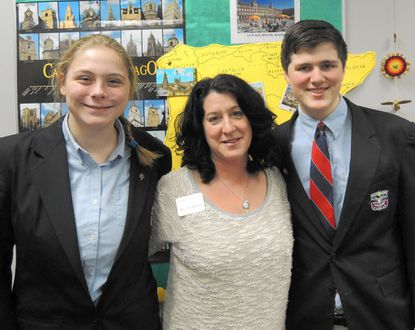 Ninth-grade students Kimberly Lapidario, left, and Zachary Brendler, right, are shown with Upper School English teacher Jackie Guenther.