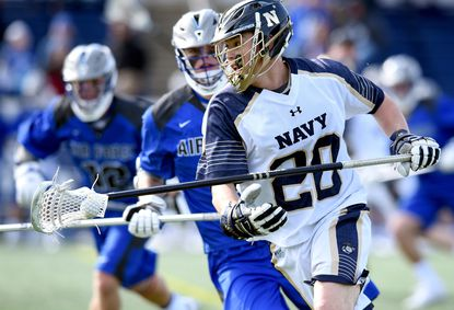 Navy's Matt Rees advances the ball in the fourth quarter. Tof a 2016 game against Air Force