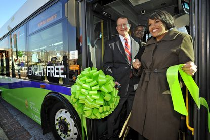 Mayor Stephanie Rawlings-Blake, right, was joined by Ronald Peterson, president of Johns Hopkins Hospital, left, Baltimore City councilman Warren Branch, center, and other community and city representatives for a ribbon-cutting to celebrate the launch of the Charm City's Circulator Green Route. The new route runs between Guilford Avenue, City Hall, Harbor East, Fells Point, and Johns Hopkins Hospital.