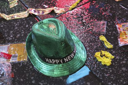 """FILE - In this Jan. 1, 2019, file photo a """"Happy New Year"""" hat lies on the wet ground along with other items following the celebration in New York's Times Square. Setting a New Year's resolution about improving your finances is an excellent way to start 2021. But before you come up with a list of goals, be aware that there are a few you should avoid. (AP Photo/Tina Fineberg, File)"""