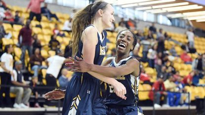 Catonsville's Gabby Douglas, left, is embraced by teammate Jasmine Dickey after hitting a three-point shot against North Point during the 2017 Class 4A state semifinals. Douglas and Dickey, who will play at the University of Delaware next year, return for the Comets this season.