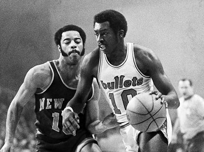 Bullets guard Earl Monroe drives around Knicks guard Walt Frazier. The teams met for the 1971 Eastern Conference championship.