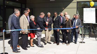 County Executive Allan Kittleman and Charles Dorsey, son of civil rights activist Leola Dorsey, cut the ribbon at the opening of the Leola Dorsey Community Resource Center on Oct. 2.