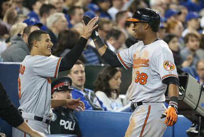 Jimmy Paredes is congratulated by Manny Machado after hitting a two-run home run in the third inning Wednesday night.
