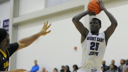 Mount St. Joseph's Daveyon Barnes shoots a 3-pointer during a basketball game in 2014. Barnes was killed in a hit-and-run in Baltimore County on Saturday.