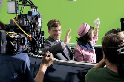 "This is how TV is re-making our national past for prime-time, entertainment television. Rob Lowe as President John F. Kennedy and his co-star Ginnifer Goodwin who plays Jackie Kennedy filming on green screen for the shooting scene in Dallas on the set ""Killing Kennedy."""