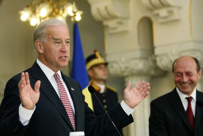 U.S. Vice President Joe Biden, left, speaks to the media during a joint press briefing together with Romania's President Traian Basescu, right, in 2009. A trip to the country a decade earlier as a U.S. senator demonstrated his mastery of international relations.