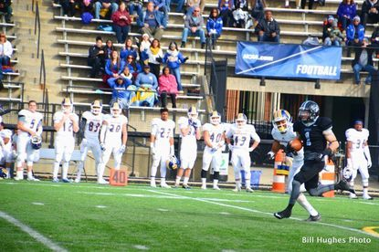 Johns Hopkins junior wide receiver Bradley Munday breaks into the open field against Western New England