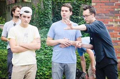"""Director Matt Porterfield (right) goes over the scene with Jeremy Saulnier (center), the Director of Photography. On the set of the film """"I Used To Be Darker,"""" in Roland Park in Baltimore City."""