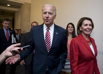 Joe Biden and Nancy Pelosi leave a meeting with the House Democratic Caucus about the Iran nuclear deal in July 2015 on Capitol Hill in Washington.