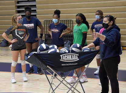 Coach Carole Ferrante instructs her players during volleyball practice at Reservoir High School, Monday March 1, 2021.