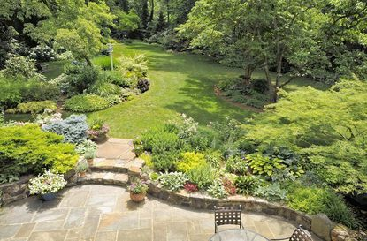 The flower beds surrounding the sunken bluestone patio have a mix of annuals and perennials in the Phoenix garden of Ed and Sally Barker.