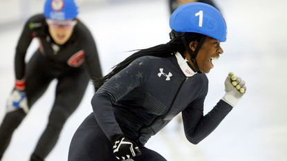 Maame Biney celebrates after winning the women's 500-meter final A during the U.S. Olympic short track speedskating trials in Kearns, Utah on Dec. 16, 2017. Biney is the first black female skater to make a U.S. short track Olympic team.