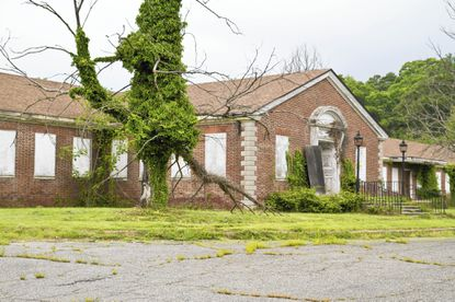 A shuttered building on the Spring Grove Hospital campus in Catonsville near Interstate 695 is shown.