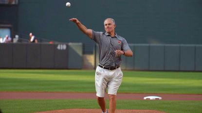 Maryland football coach DJ Durkin throws out the ceremonial first pitch before an Orioles game at Camden Yards.
