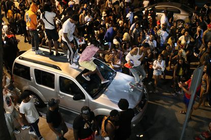 Young people gather without masks for social distancing prior to the 8 p.m. curfew in Miami Beach, Florida on Sunday, March 21, 2021. (Joe Raedle/Getty Images).