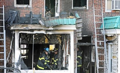 An elderly woman was found dead inside a two-story rowhouse by firefighters responding to the blaze in the 2600 block of E. Biddle St.