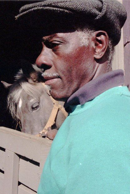 "Baltimore City-- A-Rabs, vendors who sell produce and vegetables via horse-drawn carts are slowly fading away in Baltimore. Once hundreds of a-rabs roamed the city selling their wares. Today there are only a handful left. (Above) Eugene ""Fatback) Allen with one of his prize ponies.. photo by Andre lambertson/staf"