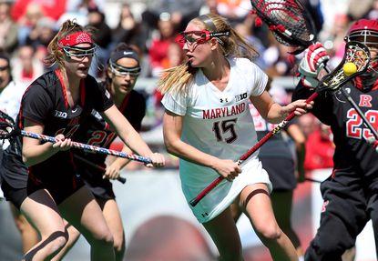 Maryland midfielder Zoe Stukenberg (Marriotts Ridge) looks to escape pressure from Rutgers goalie Candice Dandridge, right, and midfielder Jenny Vlahos.