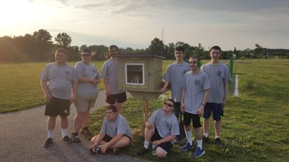 Special needs Boy Scout Troop 4513 helps make Little Free Library for Shucks Road park