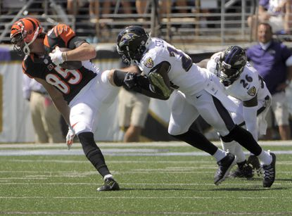Ravens safeties Darian Stewart and Matt Elam pursue Cincinnati Bengals tight end Tyler Eifert in Week 1.